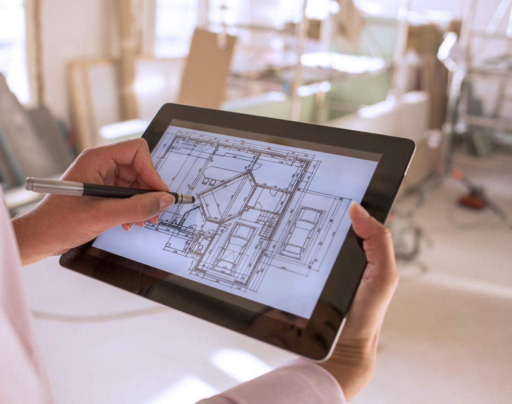 Architect working with stylus on electronic tablet